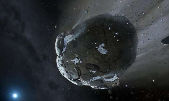 Artist's impression of a rocky and water-rich asteroid being torn apart by the strong gravity of the white dwarf star. Similar objects in the Solar System likely delivered the bulk of water on Earth and represent the building blocks of the terrestrial planets. Credit: copyright Mark A. Garlick, space-art.co.uk, University of Warwick